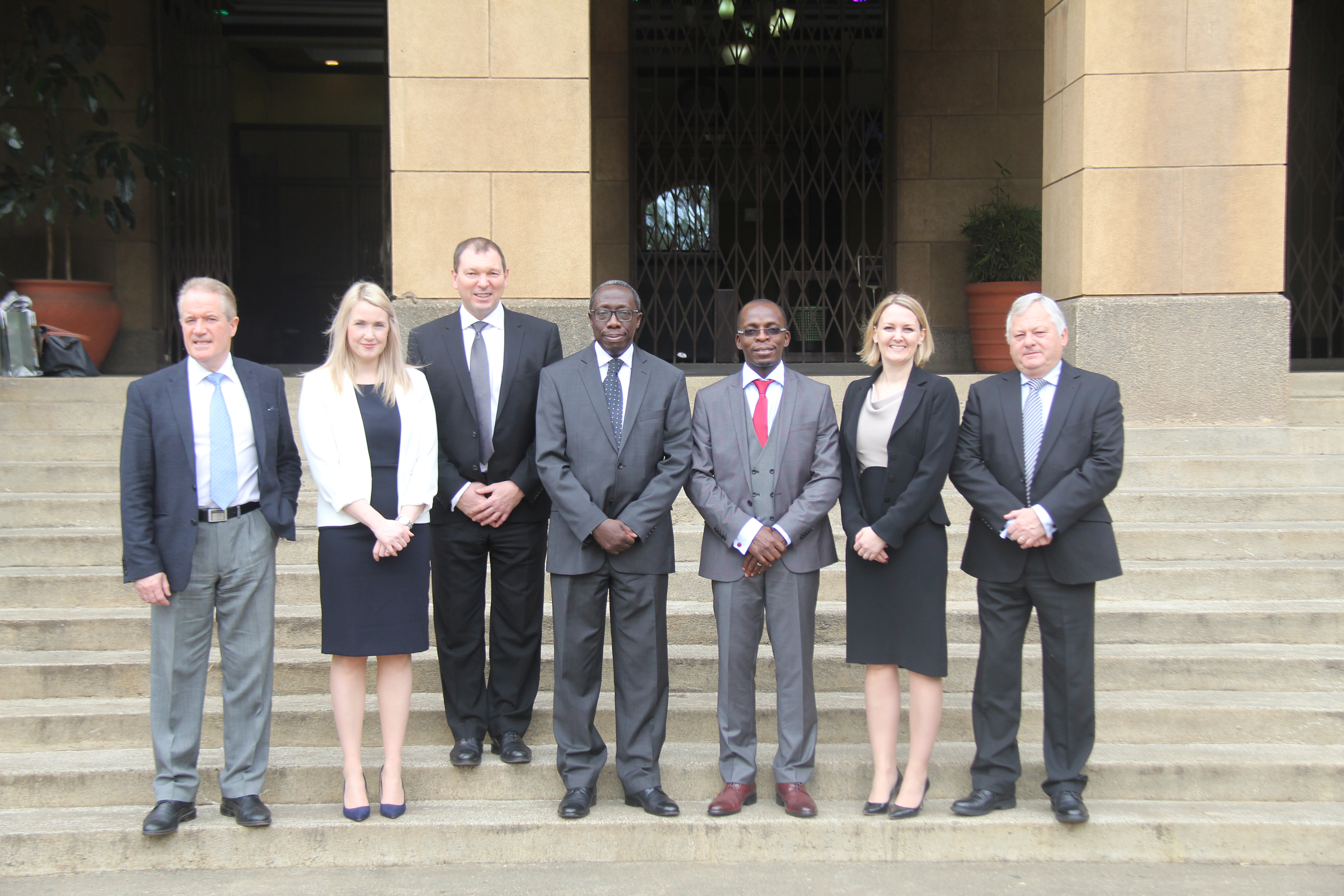 Court of Appeal President, Justice William Ouko (4th L) is joined by visiting solicitors from Hugh James firm in the UK, they paid a courtesy call on the Court.